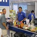 Tim buys groceries at FoodTown - it was crowded, but they gave out free wine samples!