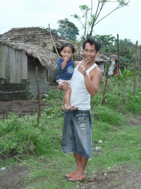 A guy posing with his cute little kid