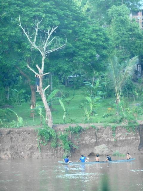 Locals jumping in the Mekong