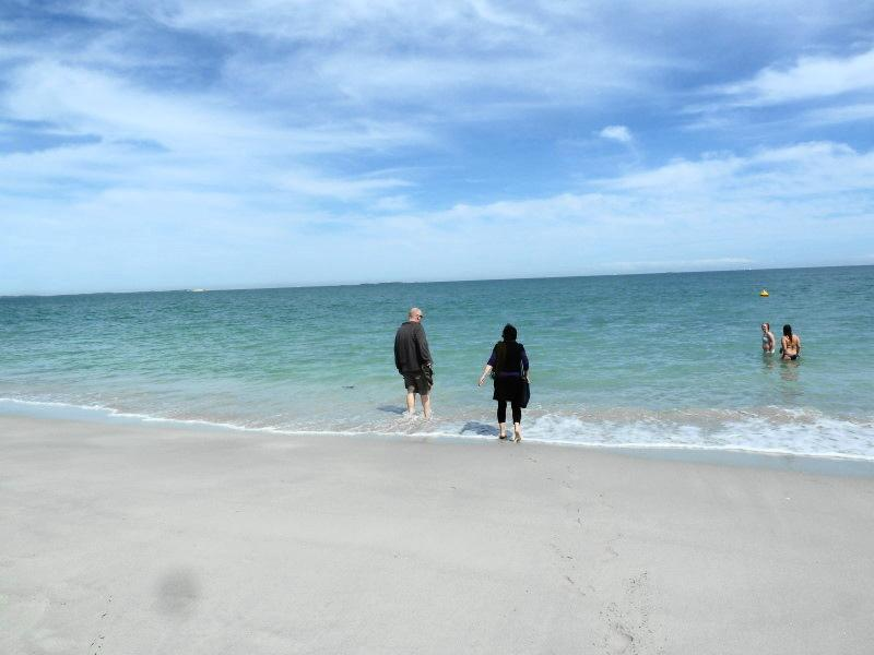 Chris and Gill dipping their feet in the icy water