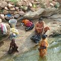 women washing their clothes and theirselves