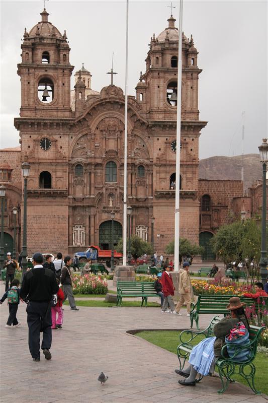 Sleeping on a bank in Cusco`s plaza de armas