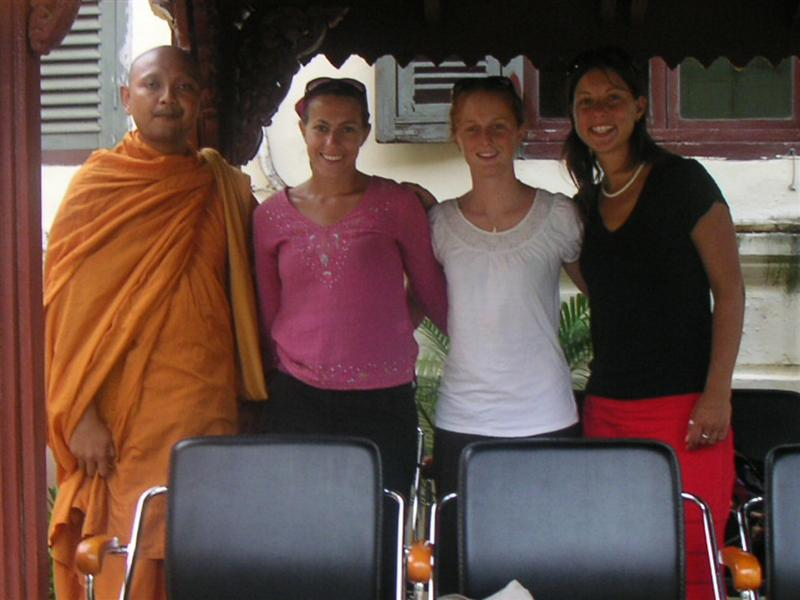 Buddhist monk (one of the many you see around) (but one of the few caught taking photos of US)