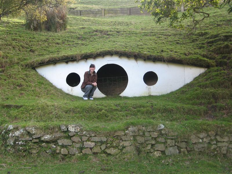 Ang next to a Hobbit hole