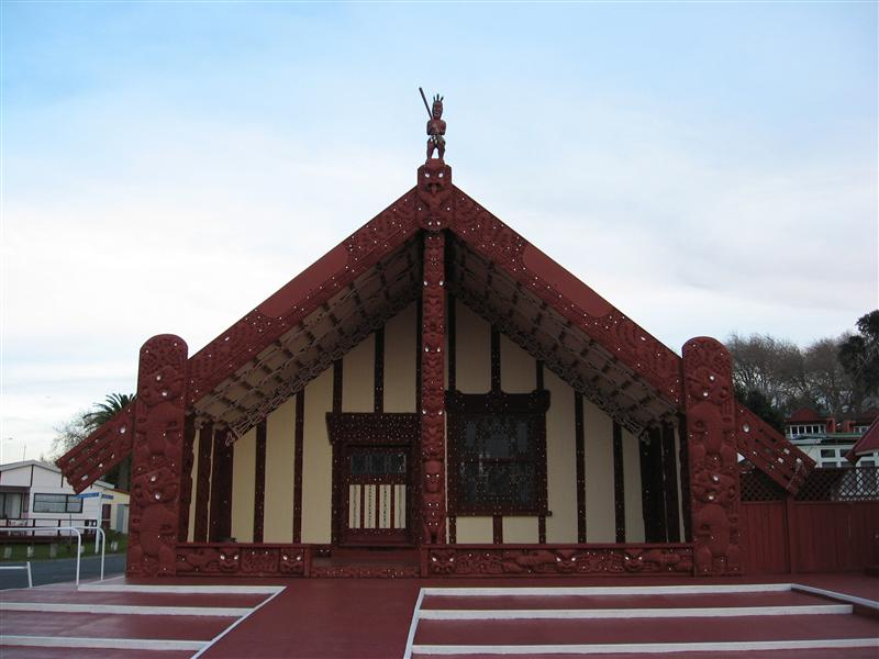 A traditional Maori meeting house with intricate carvings