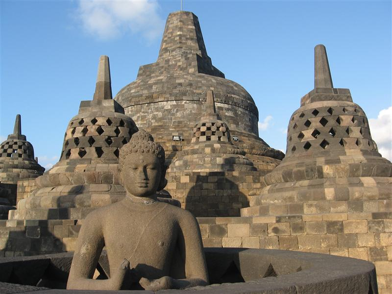 A buddha without his casing, and top of Borobudur