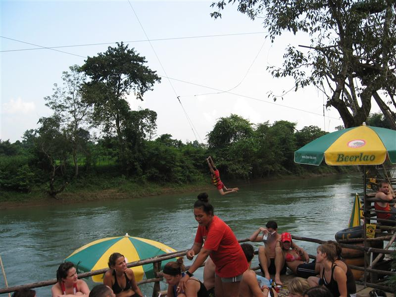 Rope swing from a bar during the tubing