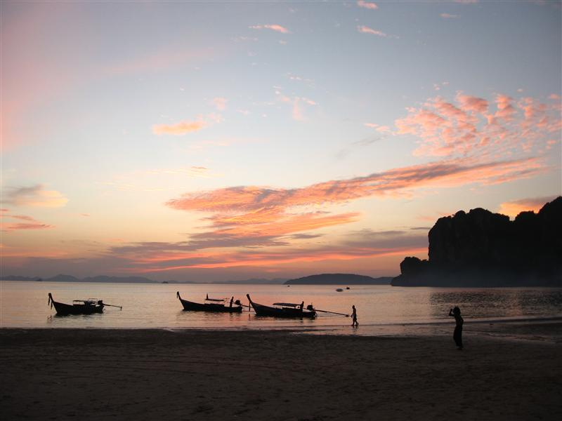 Longtail boats at sunset on West Beach