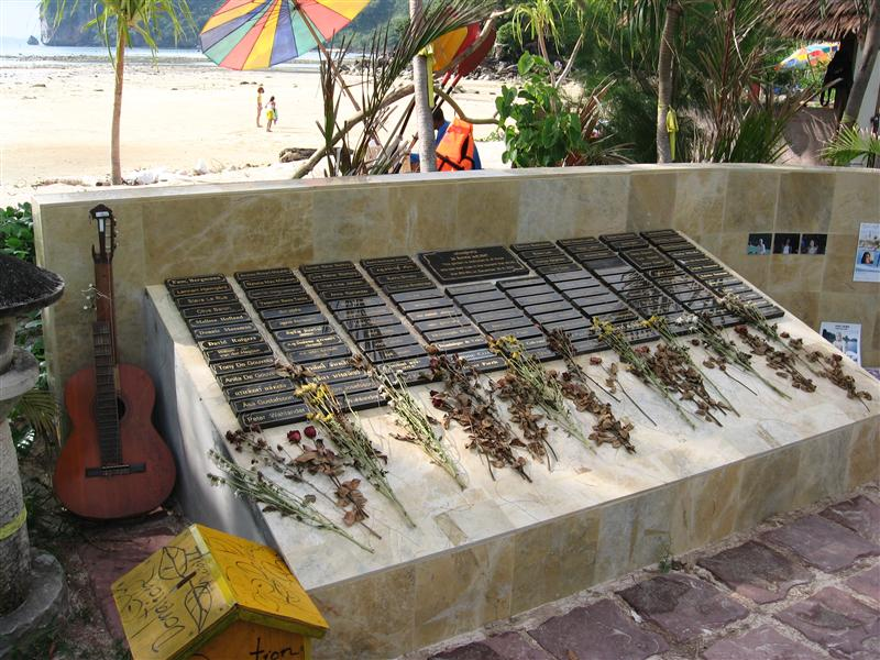Memorial plaques and photos by the beach, Phi Phi