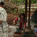 Participant preparing ayahuasca brew