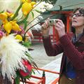 Mary photographing floral display at Sumiyoshi shrine
