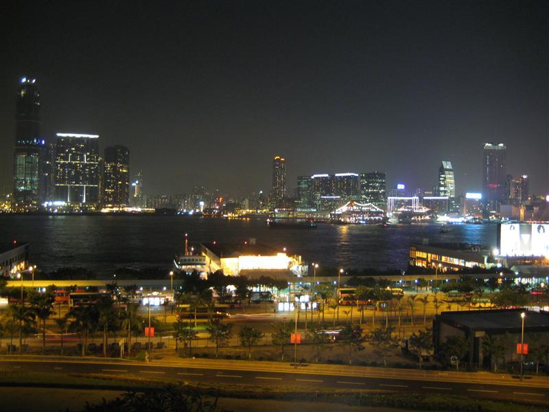 Kowloon at night across the south China sea, from Hong Kong island.