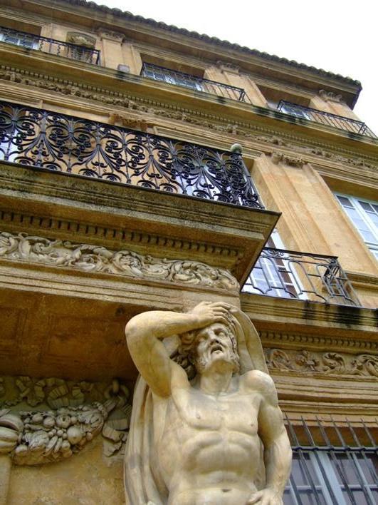 a statue in 1 of d gardens in Aix-en-Provence, he looks like he has a headache from d balcony on its head.