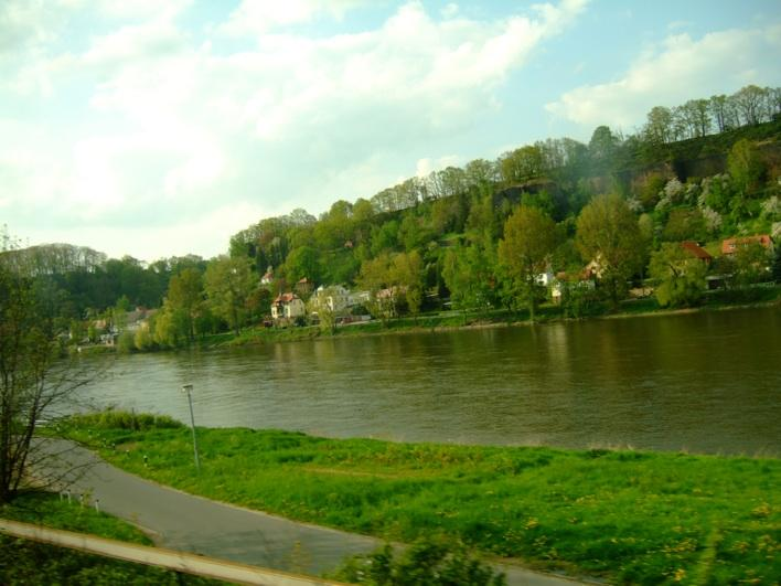 houses along the river - taken during train ride, near Czech border