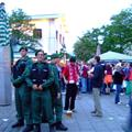 policemen making a formation at the area where free beers are given out