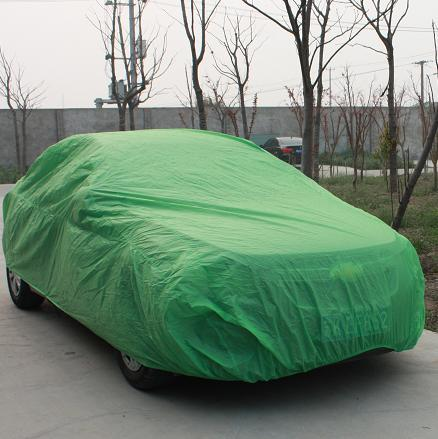 Green car covers on the trip