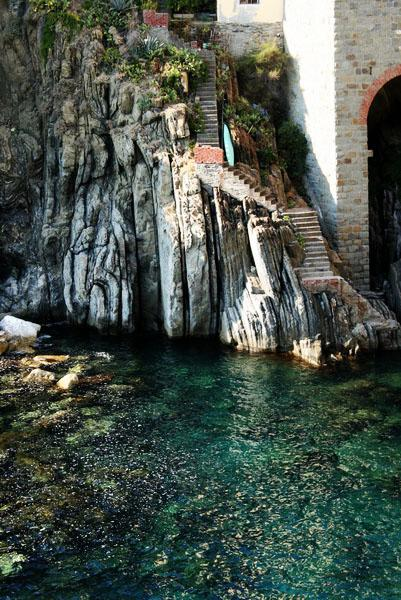 A walkway down to the water in Riomaggiore