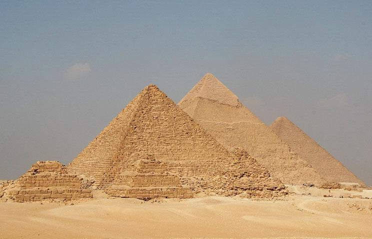 Pyramids of Menkaure, Khafre, and Khufu, and wives/childrens in front