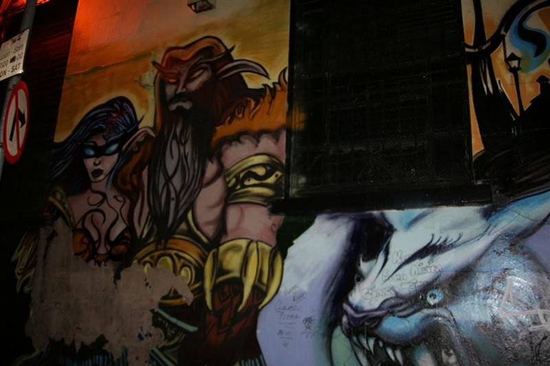 Painting on side wall of Internet Cafe...cant get away from WOW