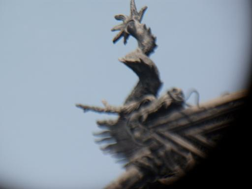 Mythical creature on eave of temple roof