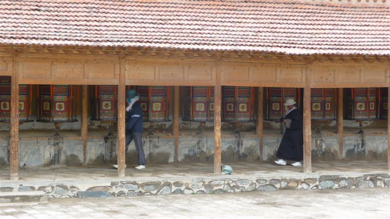 Prayer wheels along the kora