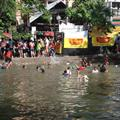 Loads of kids swim in the moat (and some adults)