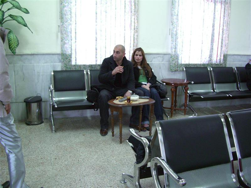 Bivar and wife drinking tea at Iraqi immigration.