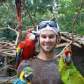 Ryan with Macaws