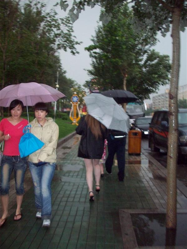 Teenager. High heels come in handy in the flash flood. A little dangerous though.