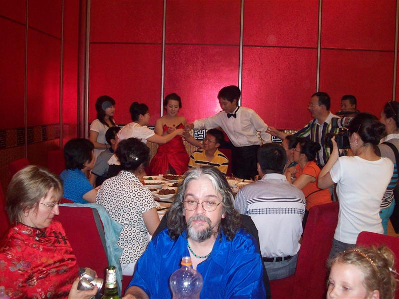The bride & groom toast each table, about 20. She's drinking H2O, he's toasting with chinese moonshine, baijiu