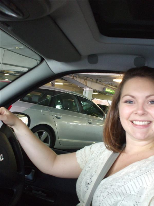 Vanessa in her Clio