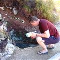 Robert checking out if the 'hot' spring is hot. (It was boiling...)