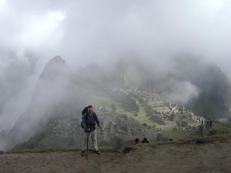 Standing before misty Machu Picchu